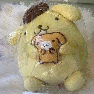 Pompompurin holding muffin